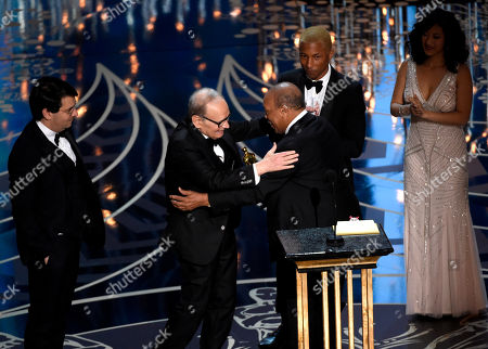 Quincy Jones, center, and Pharell Williams, right, present Ennio Morricone with the award for best original score for The Hateful Eight at the Oscars, at the Dolby Theatre in Los Angeles