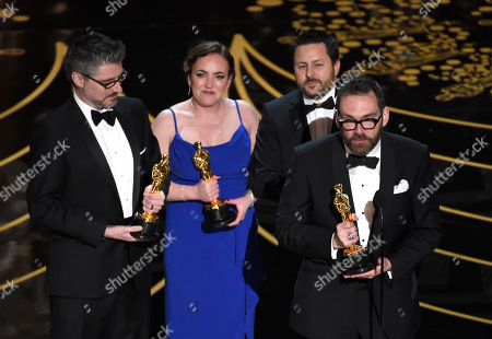 Mark Ardington, from left, Sara Bennett, Paul Norris, and Andrew Whitehurst accept the award for best visual effects for Ex Machina at the Oscars, at the Dolby Theatre in Los Angeles