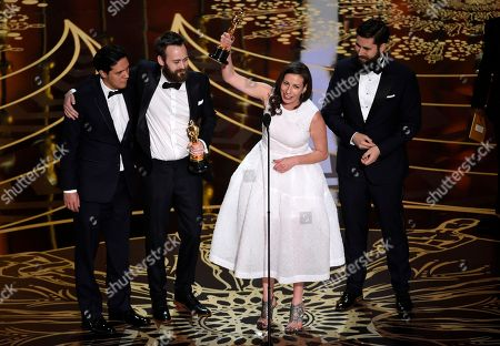 Shan Christopher Ogilvie, from left, Benjamin Cleary, Serena Armitage, and Michael Paleodimos accept the award for best live action short film for Stutterer at the Oscars, at the Dolby Theatre in Los Angeles