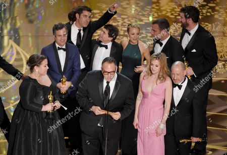 """Nicole Rocklin, front row from left, Michael Sugar, Blye Pagon Faust, Steve Golin, and, second row from left, Mark Ruffalo, Josh Singer, Michael Rezendes, Rachel Mc Adams and Liev Schrieber appear on stage to accept the award for best picture for """"Spotlight"""" at the Oscars, at the Dolby Theatre in Los Angeles"""
