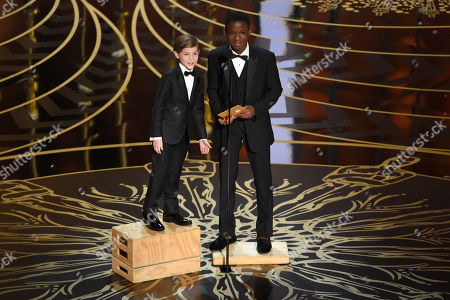 Jacob Tremblay, left, and Abraham Attah present the award for best live action short film at the Oscars, at the Dolby Theatre in Los Angeles