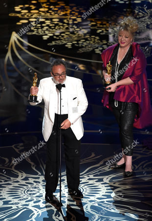 Colin Gibson, left, and Lisa Thompson accept the award for best production design for â?œMad Max: Fury Roadâ?? at the Oscars, at the Dolby Theatre in Los Angeles