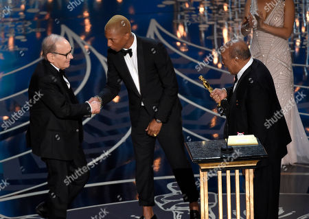 Pharell Williams, center, and Quincy Jones, right, present Ennio Morricone with the award for best original score for â?œThe Hateful Eightâ?? at the Oscars, at the Dolby Theatre in Los Angeles