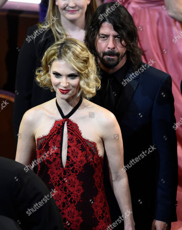 Jordyn Blum, left, and Dave Growl appear in the audience at the Oscars, at the Dolby Theatre in Los Angeles