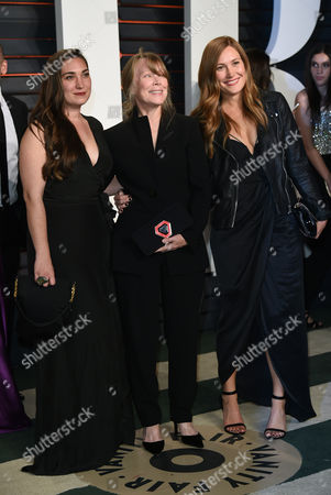 Stock Image of Madison Fisk, from left, Sissy Spacek, and Schuyler Fisk arrive at the Vanity Fair Oscar Party, in Beverly Hills, Calif