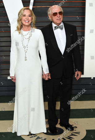 Jane Slagsvol, left, and, Jimmy Buffett arrive at the Vanity Fair Oscar Party, in Beverly Hills, Calif