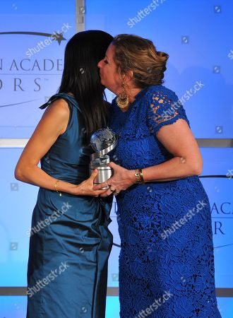 "MAY 2: (L-R) TV correspondent Laura Ling present The Academy honor award for ""Women, War & Peace"" to executive producer Abigail Disney onstage at the Academy of Television Arts & Sciences Presents ""The 5th Annual Television Academy Honors"" at the Beverly Hills Hotel on in Beverly Hills, California"