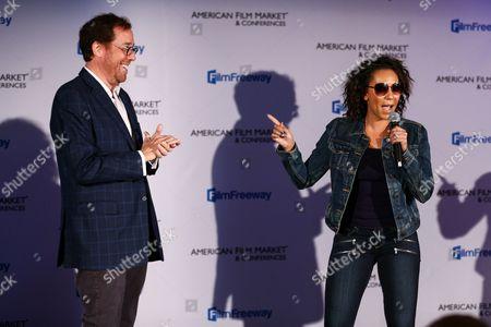 Rob Minkoff, left, and Mel B attend the GFM Blazing Samurai Presentation during the American Film Market held at the Loews Santa Monica Beach Hotel, in Santa Monica, Calif