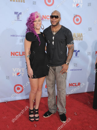Flo Rida, right, and Stayc arrive at the ALMA Awards, in Pasadena, Calif