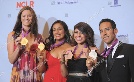 From left, Jessica Steffens, Brenda Villa, Marlen Esparza and Leonel Manzano pose backstage with their Olympic medals at the ALMA Awards, in Pasadena, Calif
