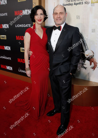 """Matthew Weiner, right, and Linda Brettler arrive at AMC's Black & Red Ball to celebrate the final episodes of """"Mad Men"""" at Dorothy Chandler Pavilion, in Los Angeles"""