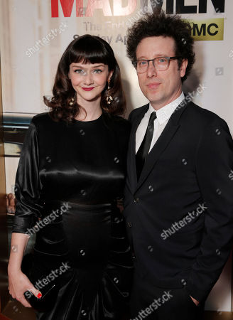 "Stock Image of Alexandra Ella, left, and Justin Meldal-Johnsen arrive at AMC's Black & Red Ball to celebrate the final episodes of ""Mad Men"" at Dorothy Chandler Pavilion, in Los Angeles"