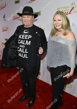 """Micky Dolenz, of the musical group The Monkees, left, and Donna Quinter arrive at AMC's Los Angeles premiere of """"Better Call Saul"""" at Regal Cinemas LA Live on"""