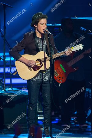 Sam Woolf performs on stage at the American Idol XIII finale at the Nokia Theatre at L.A. Live, in Los Angeles