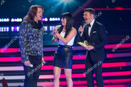 Finalists Caleb Johnson, left, and Jena Irene react as host Ryan Seacrest names Johnson the winner on stage at the American Idol XIII finale at the Nokia Theatre at L.A. Live, in Los Angeles