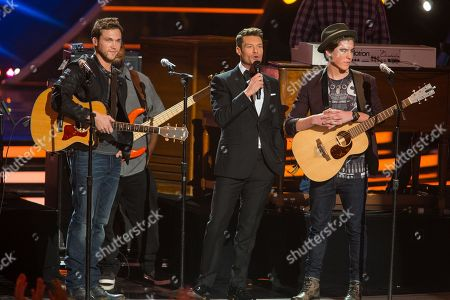 From left, Phillip Phillips, Ryan Seacrest and Sam Woolf on stage at the American Idol XIII finale at the Nokia Theatre at L.A. Live, in Los Angeles