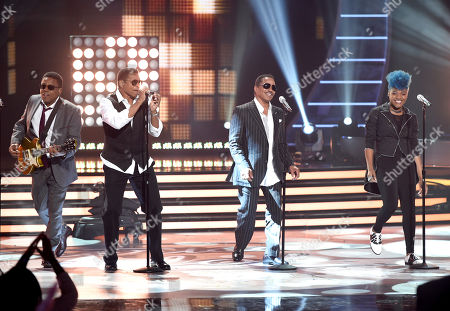 Stock Image of Tito Jackson, from left, Jackie Jackson and Marlon Jackson, of The Jackson Five, and Tyanna Jones perform at the American Idol XIV finale at the Dolby Theatre, in Los Angeles