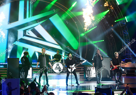 Clark Beckham, second from left, Nick Fradiani, second from right, and Fall Out Boy perform at the American Idol XIV finale at the Dolby Theatre, in Los Angeles