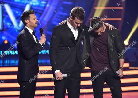 Host Ryan Seacrest, from left, Clark Beckham and Nick Fradiani await results at the American Idol XIV finale at the Dolby Theatre, in Los Angeles
