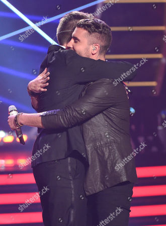 Clark Beckham, left, hugs Nick Fradiani after Fradiani is announced as the winner at the American Idol XIV finale at the Dolby Theatre, in Los Angeles