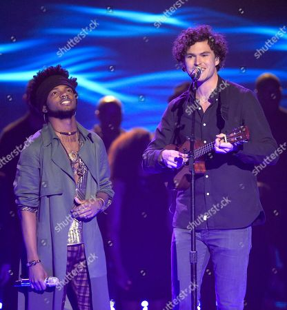 Stock Photo of Quentin Alexander, left, and Vance Joy perform at the American Idol XIV finale at the Dolby Theatre, in Los Angeles