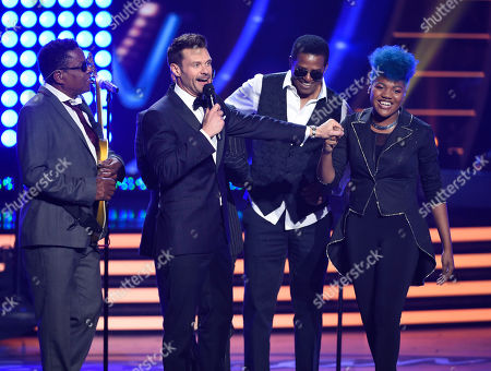 Tito Jackson, from left, host Ryan Seacrest, Jackie Jackson and Tyanna Jones speak on stage at the American Idol XIV finale at the Dolby Theatre, in Los Angeles
