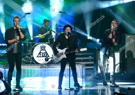 Clark Beckham, left, Nick Fradiani, right, and Fall Out Boy perform at the American Idol XIV finale at the Dolby Theatre, in Los Angeles