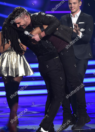 Qaasim Middleton, left, congratulates Nick Fradiani after Fradian is announced as the winner at the American Idol XIV finale at the Dolby Theatre, in Los Angeles