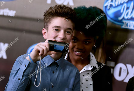 """Daniel Seavey, left, and Tyanna Jones arrive at the """"American Idol XIV"""" finalists party at The District by Hannah An on Wednesday, Mar. 11th in Los Angeles"""