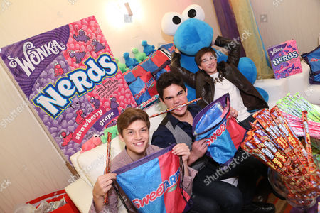 Stock Picture of From left, Singers Ricky Garcia, Emery Kelly, and Jon Klaasen of Forever In Your Mind are seen at the American Music Awards KIIS FM Wonka NERDS Gifting Suite, on Saturday, November, 23, 2013 in Los Angeles