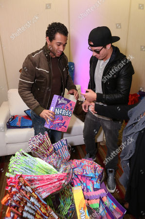 Actor Corbin Bleu, left, and actor/choreographer Beau 'Casper' Smart are seen at the American Music Awards KIIS FM Wonka NERDS Gifting Suite, on Saturday, November, 23, 2013 in Los Angeles