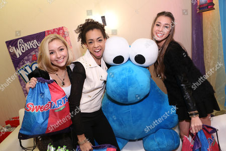 Singers Millie Thrasher, Summer Reign, Celine Polenghi of Sweet Suspense are seen at the American Music Awards KIIS FM Wonka NERDS Gifting Suite, on Saturday, November, 23, 2013 in Los Angeles