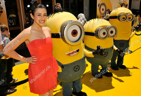 """Dana Gaier, a cast member in """"Despicable Me 2,"""" poses with minion characters at the American premiere of the film at Universal Citywalk on in Universal City, Calif"""