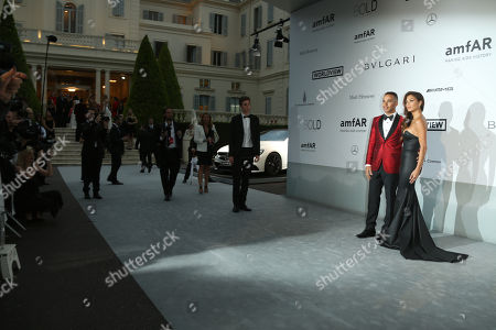 Racing car driver Lewis Hamilton and singer Nicole Sherzinger arrive at the amfAR Cinema Against AIDS benefit at the Hotel du Cap-Eden-Roc, during the 67th international film festival, in Cap d'Antibes, southern France