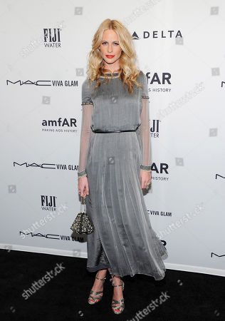 Model Poppy Delevigne attends amfAR's New York gala at Cipriani Wall Street on in New York