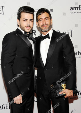 Designer Marc Jacobs, right, and Harry Louis arrive at the amfAR Inspiration gala at the New York Public Library on in New York