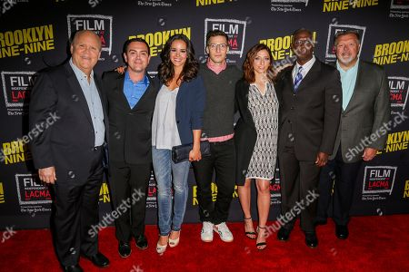 """Dirk Blocker, from left, Joe Lo Truglio, Melissa Fumero, Andy Samberg, Chelsea Peretti, Andre Braugher and Joel McKinnon Miller arrive at An Evening With """"Brooklyn Nine-Nine"""" at Bing Theatre, in Los Angeles"""