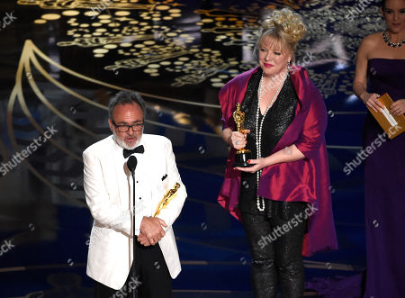 Colin Gibson, left, and Lisa Thompson accept the award for best production design for Mad Max: Fury Road at the Oscars, at the Dolby Theatre in Los Angeles