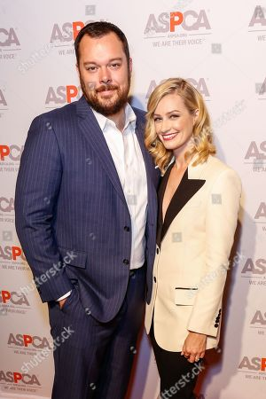 Michael Gladis, left, and Beth Behrs arrive at the ASPCA Los Angeles Benefit at a private residence in Bel-Air, in Los Angeles