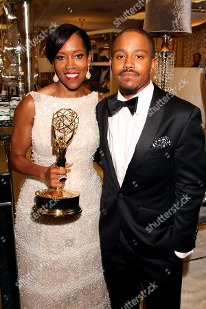 Stock Image of Regina King, left, and Ian Alexander, Jr. at the Backstage Creations Giving Suite benefiting the Television Academy Foundation Educational Programs at the 67th Primetime Emmy Awards at the Microsoft Theatre L.A. Live, in Los Angeles