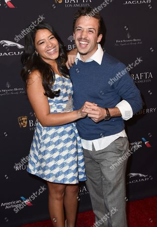 Gina Rodriguez, left, and Henri Esteve arrive at the BAFTA 2015 awards season tea party at The Four Seasons Hotel on in Los Angeles