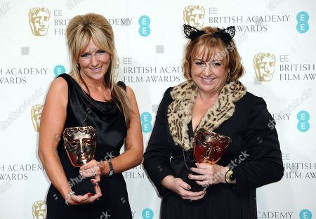 Anna Lynch-Robinson, left, and Eve Stewart pose with the Production Design award at the BAFTA Film Awards at the Royal Opera House, in London