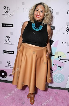 Gabi Gregg arrives at BeautyCon Los Angeles 2014 in Partnership with Elle at LA Mart, in Los Angeles