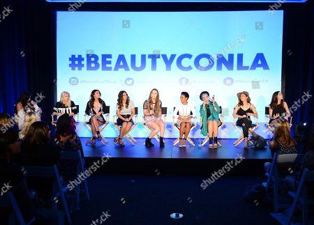 From left, Brittany Mota-Wiley, Evelina, Teni Panosian, Mindy, Alexa Losey, Shameless Maya, Kandee Johnson, Jenn Im and MakeupByMandy24 attend BeautyCon Los Angeles 2014 in Partnership with Elle at LA Mart, in Los Angeles