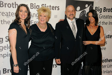 Roy P. Disney, second from right, recipient of the Walt Disney Man of the Year Award, poses with, left to right, BBBSLA president and CEO Tiffany Siart, Mary Willard and his wife Sheri at the Big Brothers Big Sisters of Greater Los Angeles' 2013 Rising Stars Gala at the Beverly Hilton Hotel on in Beverly Hills, Calif
