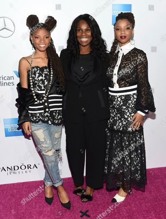Chloe Bailey, left, Yvette Noel-Schure and Halle Bailey attend the 11th Annual Billboard Women in Music honors at Pier 36, in New York. Billboard Women in Music 2016 will air Dec. 12 on Lifetime