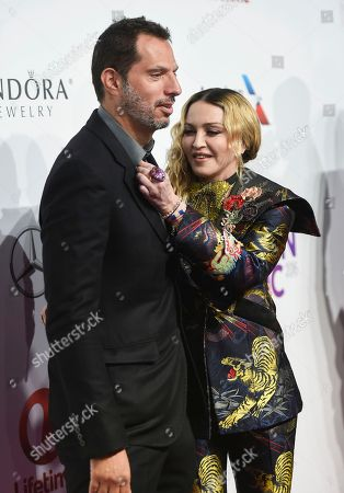 Guy Oseary, left, and Madonna attend the 11th Annual Billboard Women in Music honors at Pier 36, in New York. Billboard Women in Music 2016 will air Dec. 12 on Lifetime