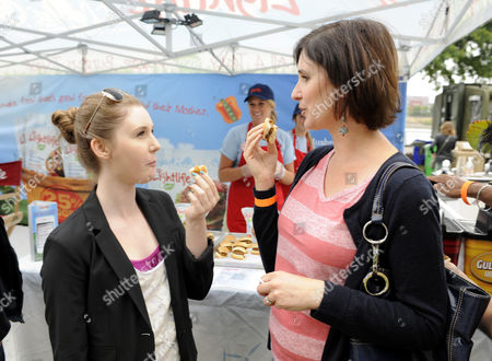 Bite of Oregon' attendees, Emilee Phillips, left, and Lisa Phillips, try asample veggie burger as they check out Lightlife's one-of-a-kind, eco-friendly event space at Governor Tom McCall Waterfront Park in Portland, Or. . In their first ever earth-friendly tour, Lightlife is drawing on its love of the environment, charitable culture and delicious meat-free products to bring a unique experience to people across the U.S