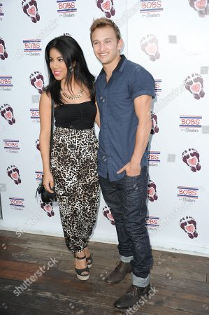 Stock Photo of Chrissie Fit, left, and Kent Boyd arrive at BOBS from Skechers' summer soiree to celebrate over 5 million donated pairs of shoes to children in need at the Skybar on in Los Angeles