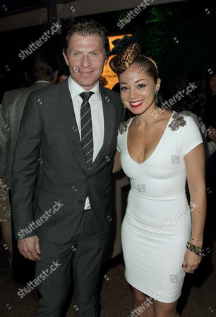 Chefs Bobby Flay, left, and Marcela Valladolid pose together at Breeders' Cup A Taste of the World at The Huntington, in San Marino, Calif
